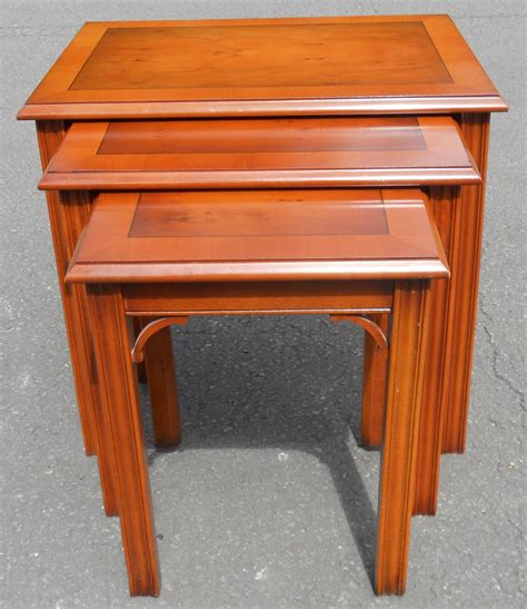 sold nest of three yew coffee tables