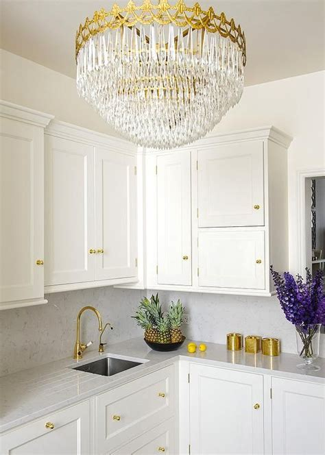 white and gold kitchen features white cabinets adorned 1000 ideas about gray quartz countertops on quartz countertops gray stained