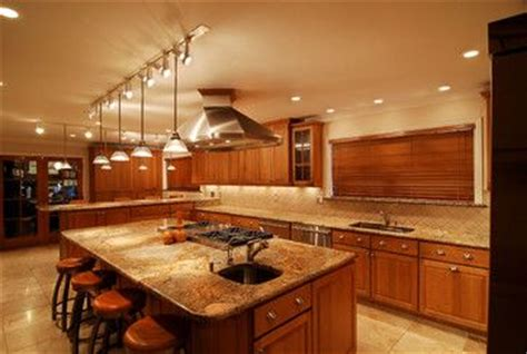 track lighting over kitchen island exle of pendants on each side of hood over island