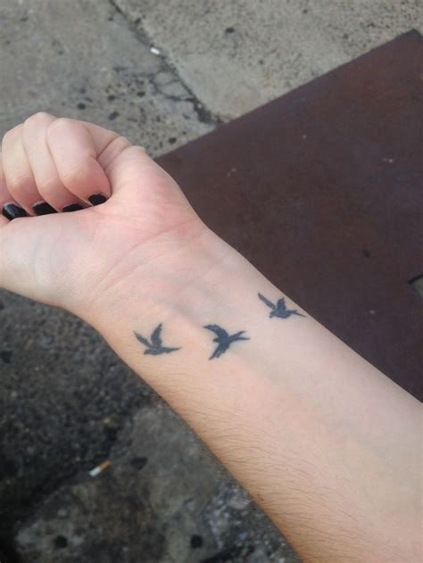 keris bird wrist tattoos