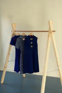 Freestanding clothing rack made of wood would integrate well in a