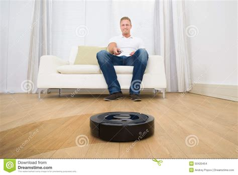 Vacuum Cleaner Happy King holding remote of robotic vacuum cleaner stock