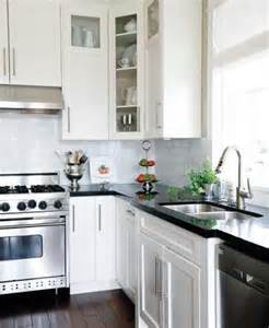 white kitchen cabinets with black granite countertops i m keeping this one black countertops white cabinets