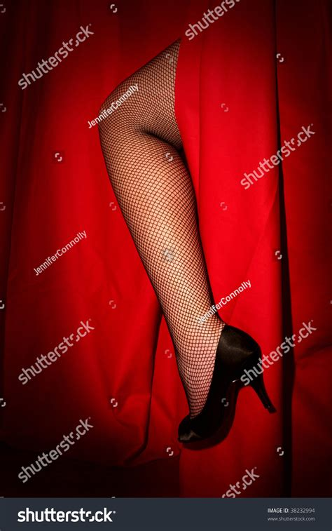 leg curtains woman s leg through red stage curtain stock photo 38232994