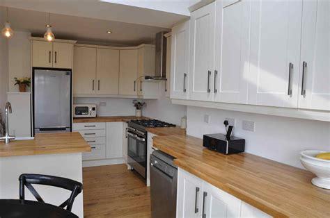 white wood kitchens bella white kitchens with wooden worktops shaker alabaster