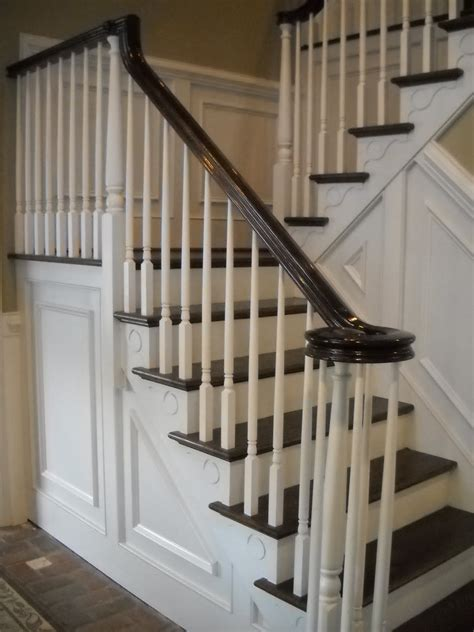 stairway banisters wood stairs and rails and iron balusters stairway