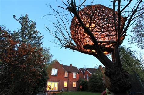 cherry tree house an illuminated woven willow tree house by tom hare colossal
