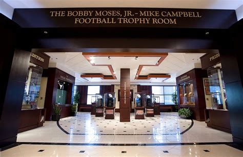 The Room Football by Bobby Moses Jr Mike Cbell Football Trophy Room