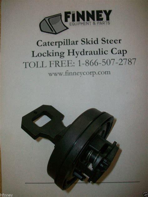 caterpillar cat skid steer loader locking hydraulic oil cap  finney equipment  parts