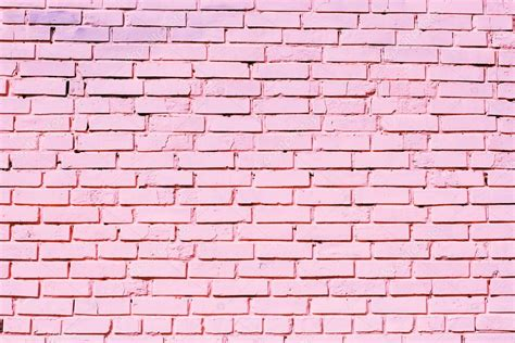 pink brick wall pink brick wall texture on street stock photo