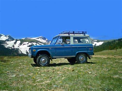 blue bronco car nice blue bronco with a rack and mountains in the