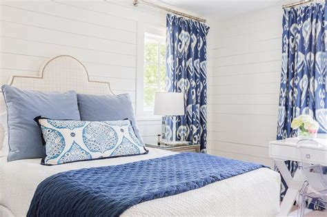 White Wall Room With Glass Windows And Blue Blinds by White And Blue Bedroom With Ikat Curtains Transitional