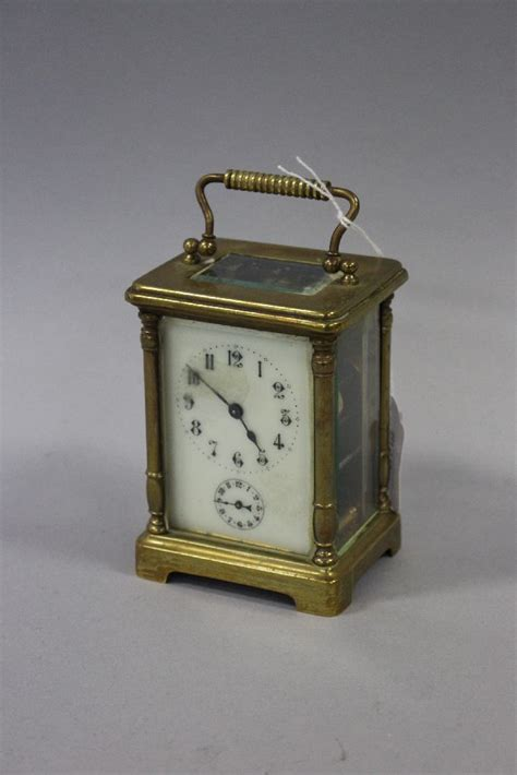 antique brass carriage alarm clock needs a clean to