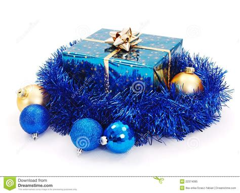 blue christmas gift surrounded with blue garland stock