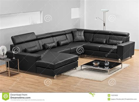Furnishing An Apartment a modern minimalist living room with leather sofa stock