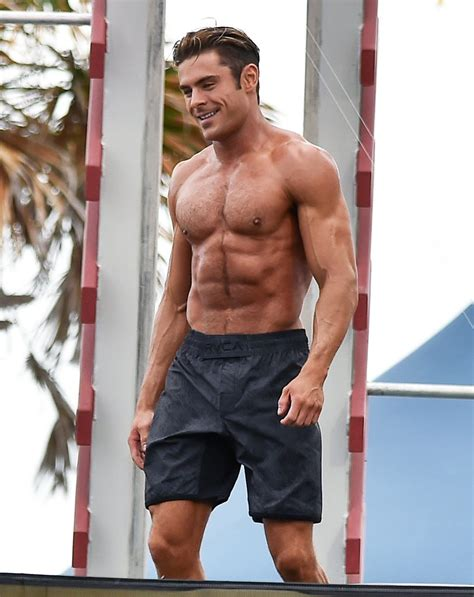 zac efron bench press zac showed off his toned body when he filmed baywatch in