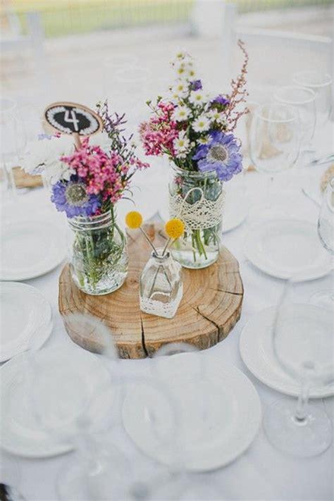 decorar tarros de cristal con puntillas flores silvestres en botes de cristal decorados con
