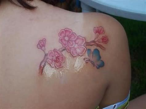 cherry blossom and butterfly tattoo designs cherry blossom tattoos me now