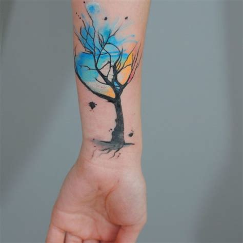 mystic tree tattoo watercolor forearm tattoo on