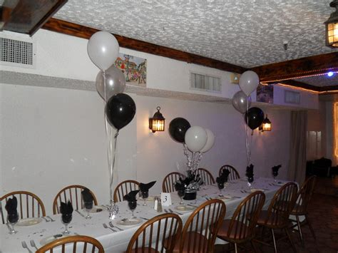 white silver and black party decorations by teresa