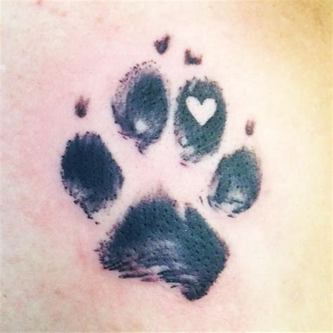 dog and cat tattoo paw print with a pawprinttatto