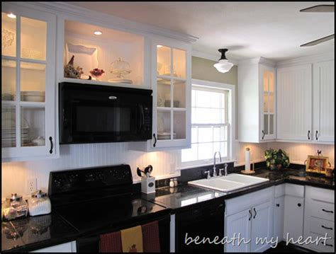 Above Microwave Cabinet by Kitchen Cabinets Design Dilemma