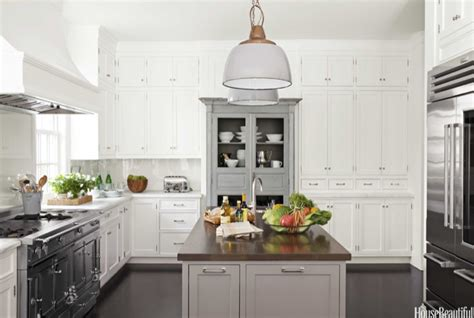 dark grey island with white countertop and antique white walnut butcher block transitional kitchen house