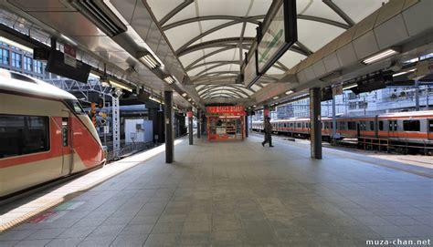 Japanese Station orange trains in shinjuku