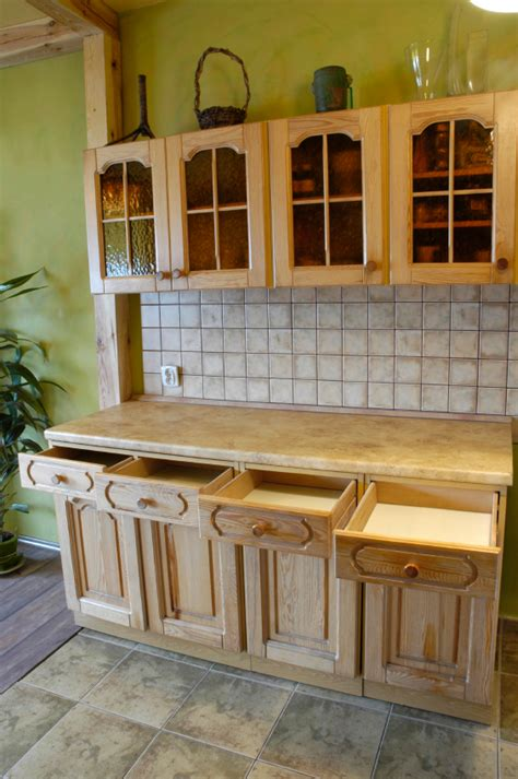 decorating tops of kitchen cabinets how to decorate the tops of kitchen cabinets lovetoknow