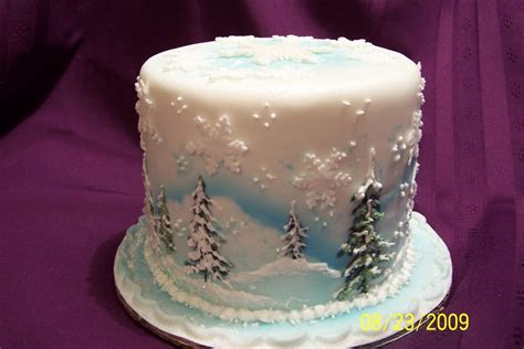 snow themed three tiered holiday cake cake or art