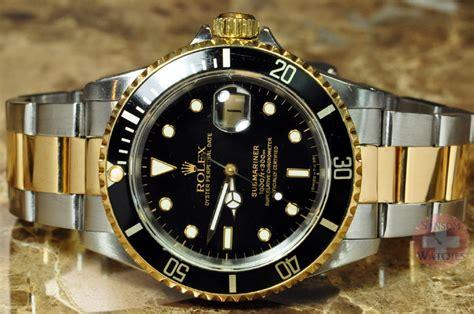 rolex submariner 18k gold steel black 16613 sansom