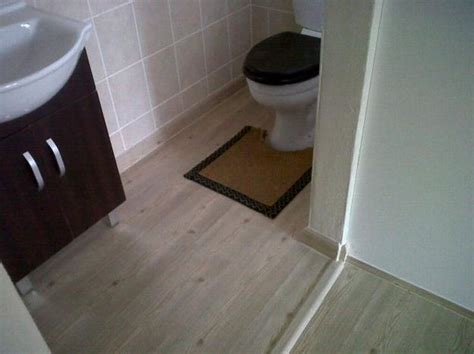 bathroom with dark hardwood floors these bathroom hardwood