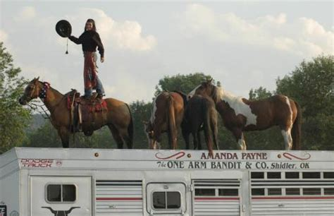 cowboy josh and amanda 2015 cowgirl loads wild mustangs on top of trailer as world