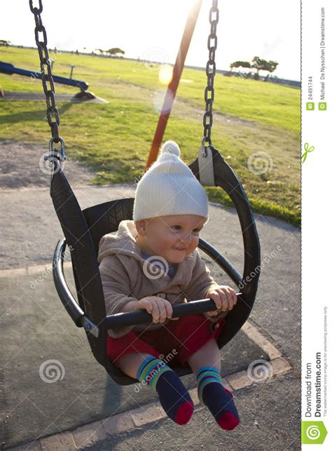 outside swings for babies baby in outdoor swing stock images image 24491744