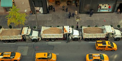 truck times dump trucks of sand protect times square