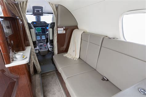 Phenom 300 Cabin by Embraer Phenom 300 Clay Lacy Aviation