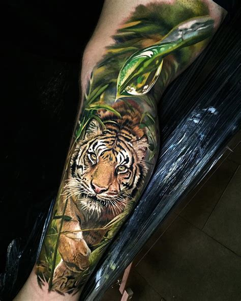 realistic tiger in the jungle best tattoo design ideas