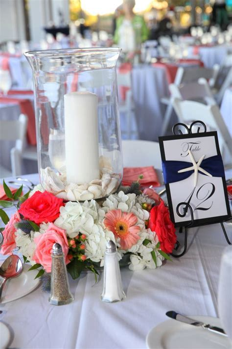 Beach centerpieces with coral flowers Beach table numbers