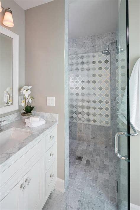white arabesque shower accent tiles transitional bathroom