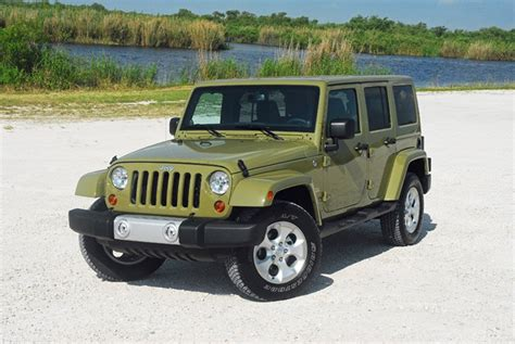 small jeep wrangler 2013 jeep wrangler four door right done small 1