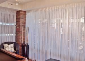 Floors And Decor Dallas high rise condo with wal to wall pinch pleated sheers