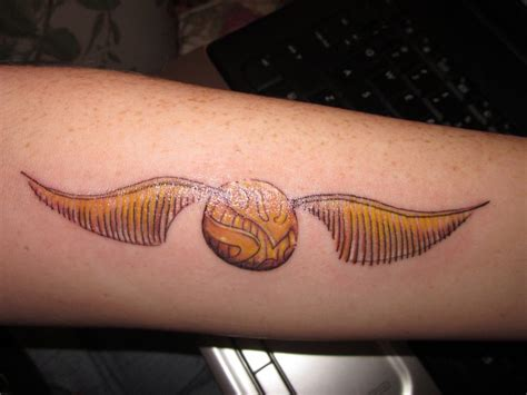 golden snitch tattoo golden snitch contrariwise literary tattoos