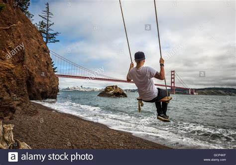 swing san francisco person on a swing with the golden gate bridge and
