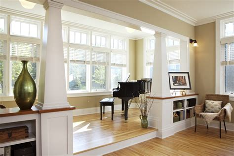 separate kitchen from living room ideas columns and built in bookshelves to separate kitchen from