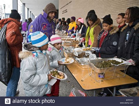 Homeless Soup Kitchen Volunteer by Volunteers Serve Meal To The Homeless At Outdoor Soup Kitchen Stock Photo Royalty Free Image