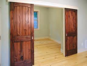 sliding doors in downstairs bedroom green home builder