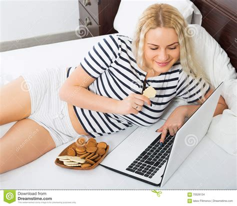 working girls in bed girl working on laptop in bed stock photo image 70526134