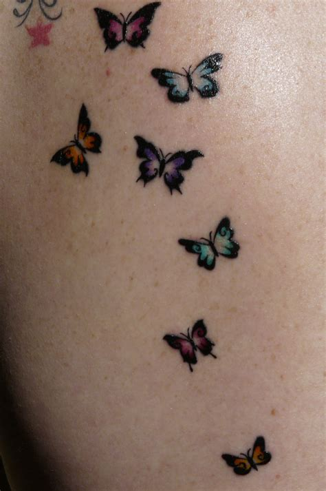 small butterfly tattoos on back simple dove design on arm cool