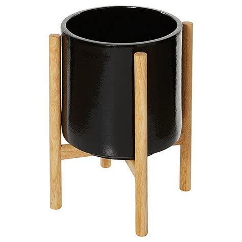 ceramic pot  wooden stand black wooden plant