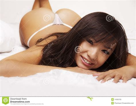 what are chinese women like in bed sexy asian woman lying in bed stock photos image 14595703